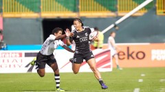Action from Round 1 of the IRB Women's Sevens World Series in Dubai as New Zealand's Honey Hireme takes a tackle against Fiji. Photo: IRB/ Martin Seras Lima