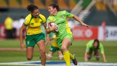 Australian captain Sharni Williams beats her Brazilian opponent during their opening match at Round 1 of the IRB Women's Sevens World Series in Dubai. Photo: IRB/ Martin Seras Lima