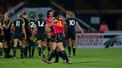 Spanish players celebrate after drawing with England on Day 1 of the IRB Women's Sevens World Series in Dubai. Photo: IRB / Martin Seras Lima