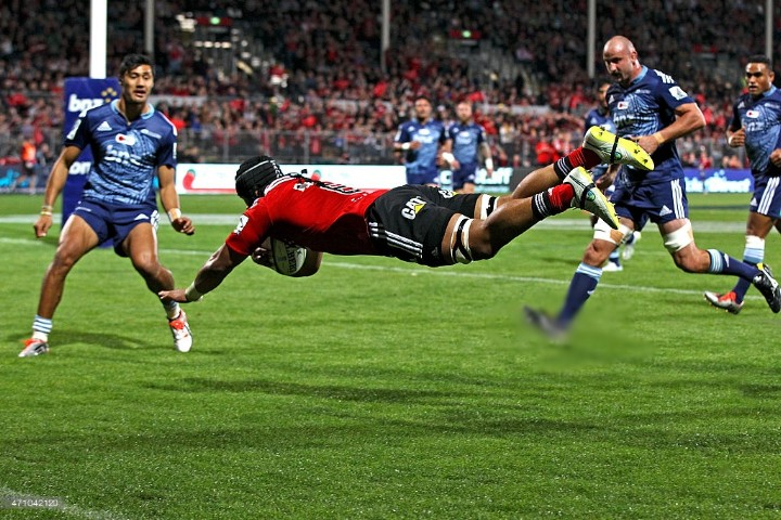 Jordan Taufua of the Crusaders dives over to score a try during the round 11 Super Rugby match between the Crusaders and the Blues at AMI Stadium on April 25, 2015 in Christchurch, New Zealand.
