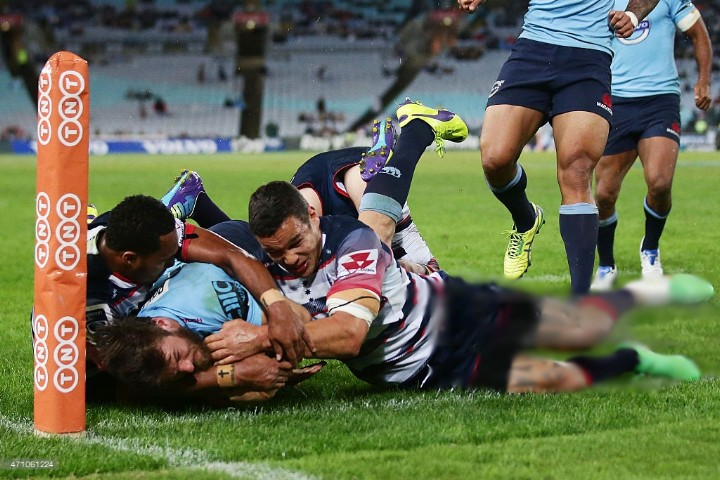 Rob Horne of the Waratahs beats the defence to score a try in the corner during the round 11 Super Rugby match between the Waratahs and the Rebels at ANZ Stadium on April 25, 2015 in Sydney, Australia.