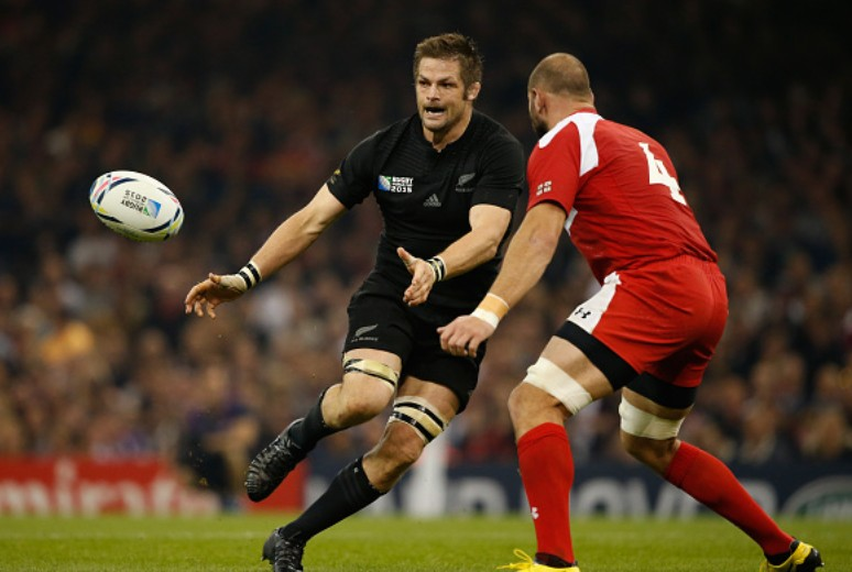 Richie McCaw of the New Zealand All Blacks passes the ball as Giorgi Chkhaidze of Georgia closes him down during the 2015 Rugby World Cup Pool C match between New Zealand and Georgia at the Millennium Stadium on October 2, 2015