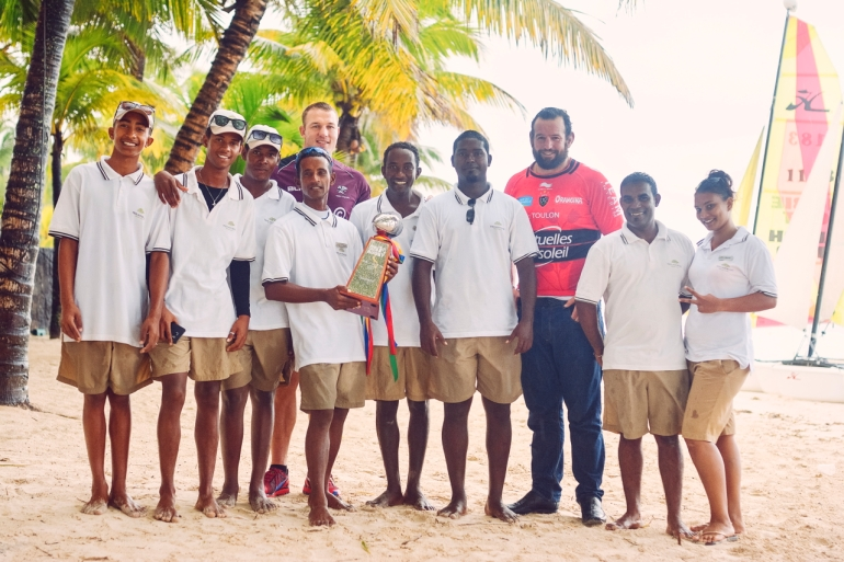 ean Deysel of the Cell C Sharks (South Africa) and Carl Hayman of RC Toulon (France) pose with staff and the WorldClub 10s trophy at Beachcomber's Trou aux Biches Resort and Spa in Mauritius. Photo: Khatleen Minerve.