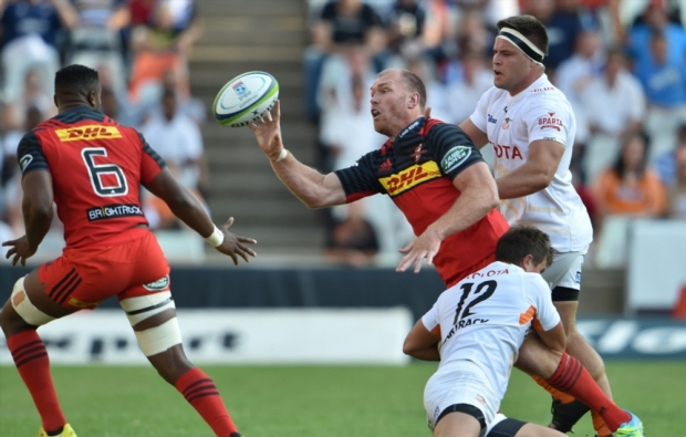 Stormers flank Schalk Burger offloads in the tackle