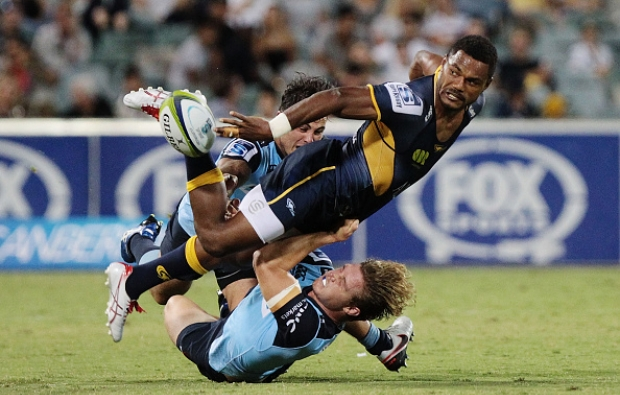Brumbies winger Henry Speight offloads against the Waratahs
