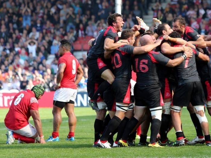 1022.6666666666666x767__origin__0x0_Georgia_team_celebrating_win_over_Tonga_at_RWC_2015
