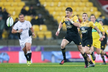 WELLINGTON, NEW ZEALAND - JULY 23: Beauden Barrett of the Hurricanes chases a loose ball during the Super Rugby Quarterfinal match between the Hurricanes and the Sharks at Westpac Stadium on July 23, 2016 in Wellington, New Zealand. (Photo by Hagen Hopkins/Getty Images)