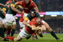 Wales' Ken Owens dives in to score the opening try during the Autumn International match at the Principality Stadium