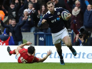 EDINBURGH, SCOTLAND - FEBRUARY 25: Tim Visser of Scotland goes past Leigh Halfpenny of Wales to score his team's second try during the RBS Six Nations match between Scotland and Wales at Murrayfield Stadium on February 25, 2017 in Edinburgh, Scotland. (Photo by David Rogers/Getty Images)